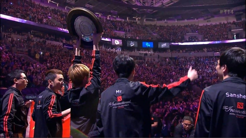 Newbee raise the Aegis trophy in front of an ecstatic crowd at The International 2014 in Seattle