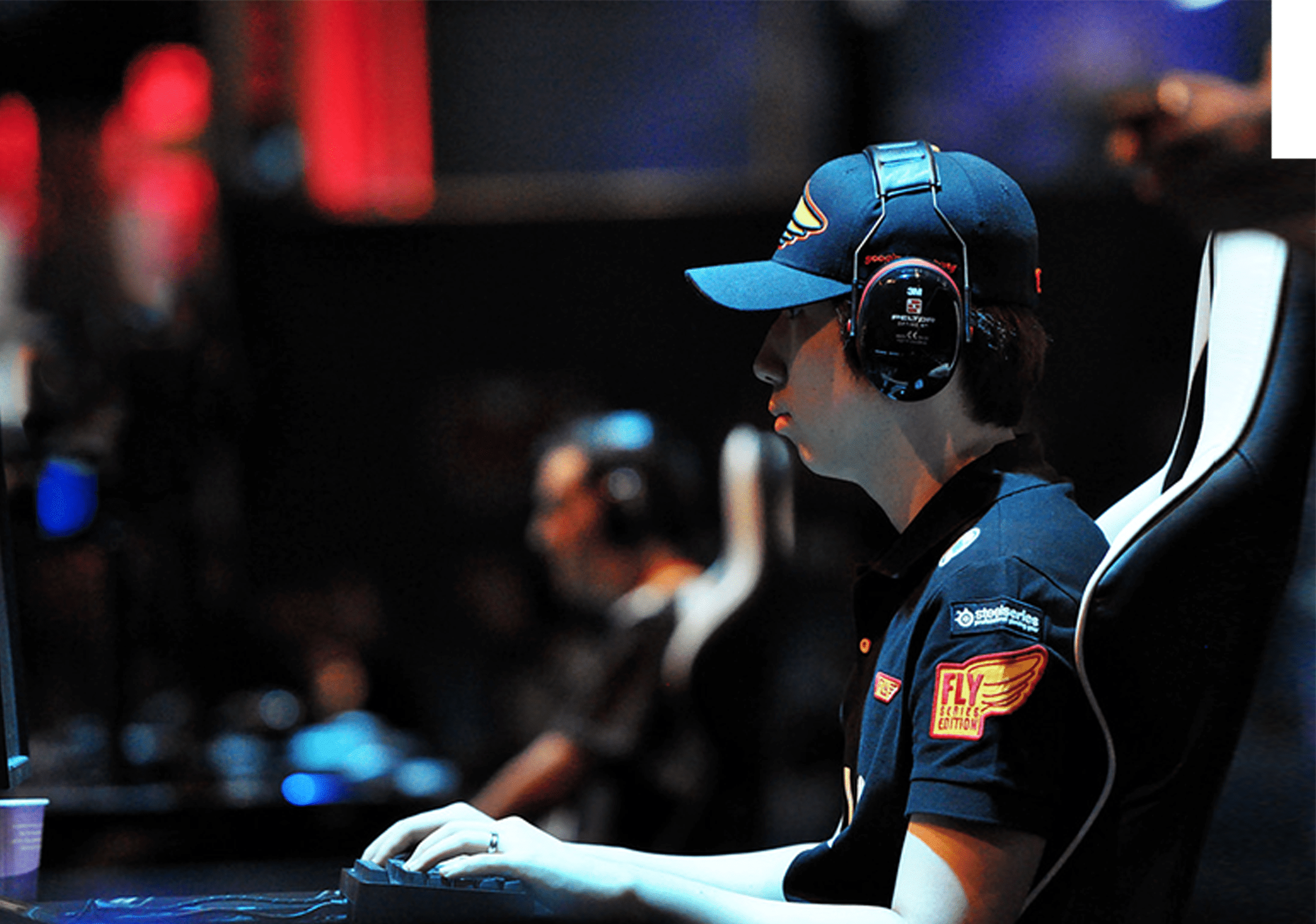 Side profile of a pro-gamer playing at a tournament