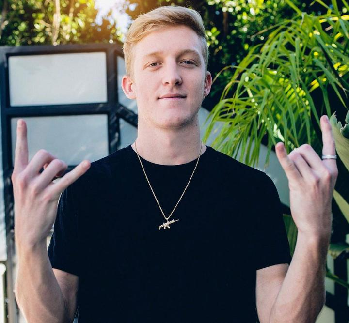 Tfue making the rock-on sign with is hands
