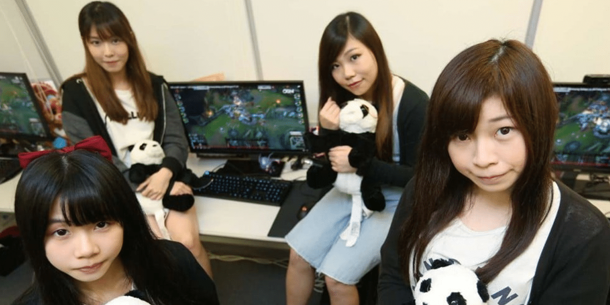 Asian girl gamers gathered around gaming pcs
